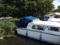 23' Norman Cruiser with 25hp outboard
