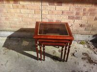 Nest of 3 wooden tables with glass inset and gold rim