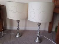 PAIR OF SILVER LARGE TABLE LAMPS - SILVER WITH CREAM SHADES