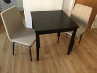 IKEA Lerhamn table (74X74cm) and 2 IKEA Preben chairs (90cm height) . RRP £200 if bought instore.