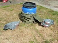 Pigeon shell decoys in plastic drum seat.