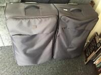 2 large grey suitcases