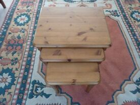 NEST OF 3 SOLID PINE TABLES (USED LARGEST SHOWS WARE )