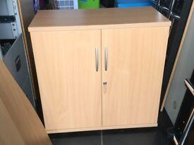 Beech 2 door cupboard with 2 shelves and key.