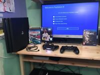 Playstation 4 pro 1TB console and extras