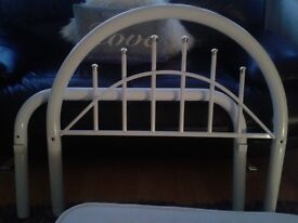 White metal framed single bed with silent night mattress
