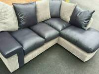 Stunning BRAND NEW black and grey corner sofa .still boxed.amazing design.can deliver