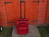 Red Wheeled Suit Case Carry on size for Airplanes