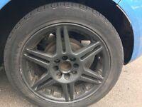Multi stud black alloys wheels