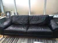 Large modern style black leather sofa