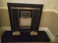Black marble hearth and Victorian cast iron solid fuel fire fret.
