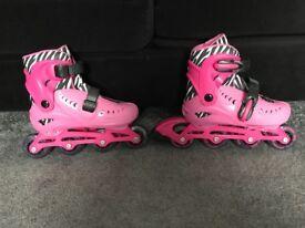 Pink zinc inline roller skates
