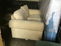 Lovely two seat sofa in pale yellow