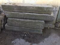 Selection of 'fossil' stone slabs and York stone steps.