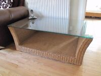 Large Rattan coffee table with glass top. In lovely condition and ready to go for the summer.