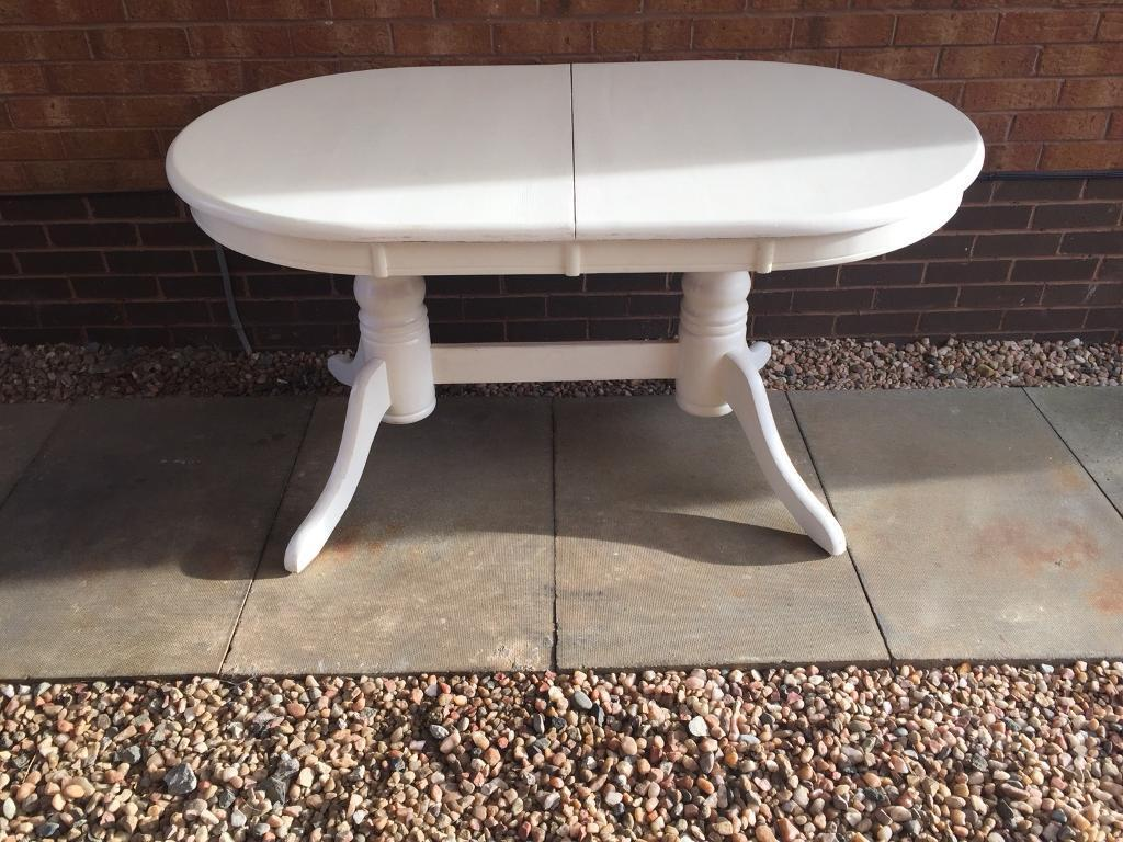 White solid wood extendable table