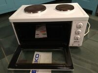Electrical Compact Cooker includes 2 hotplates, oven and grill operation.