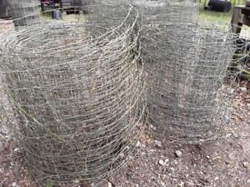 Various rolls of sheep netting