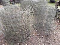 Various rolls of sheep netting