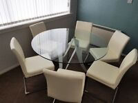 circular dining room glass table and Faux leather chairs white/chrome as new.
