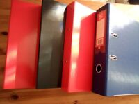 4 black and red ring binders