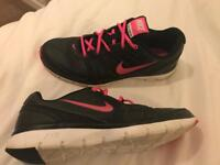 Pink and black Nike trainers size 7