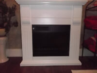 Excellent condition electric fireplace and surround