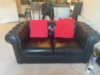2 black leather Chesterfield sofas RRP 1,000