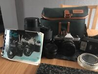 yashica fx-d film camera with three lens and converter and camera bag