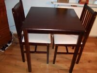 Beautiful table and 2 chairs non spot just new
