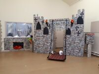 Free Castle Prop. Made out of cardboard boxes but very effective for a short term project.