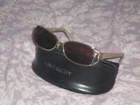 Pair of Givenchy Ladies sun glasses (as new)