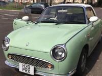 Mint green Nissan Figaro