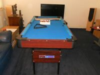 5 ft folding pool table with all accessories, 2 cues, chalk , spots and stripes balls and triangles.