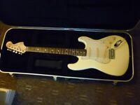 Fender Squier in hard case.