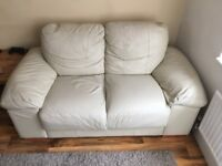 Two Cream Leather Two Seater Sofas