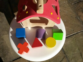 Wonderworld wooden shape-sorting house with 6 shapes