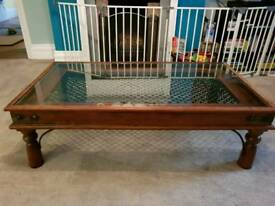 Hardwood glass top coffee table with wright iron detailing