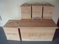 Matching wooden bread bin and biscuits, coffee, tea & sugar caddies/metal handles. £6 ovno the lot