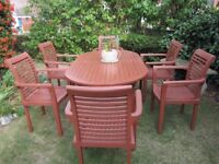 LARGE EXTENDABLE HARDWOOD GARDEN TABLE AND SIX CHAIRS, VGC