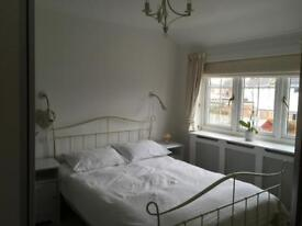 Clean double room shared with family