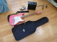 Pink Electric Guitar inc. amp/speaker, case and stand