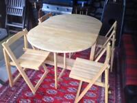 Folding table and 4 chairs.