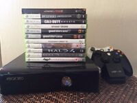 XBOX 360 Elite 250gb Console, all cables, 2 Controllers, rechargeable battery packs and 11 games