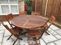 Hardwood patio table and 6 chairs. SOLD