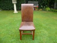Six distressed leather dining chairs