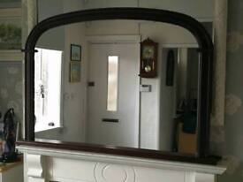 Large overmantle mirror in mohogany wooden frame.