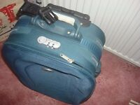 black luggage trolley case with briefcase type division for papers hand