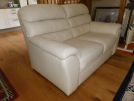 A Two Seater Cream Leather Settee