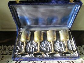 set of 4 vintage engraved metal goblets in case